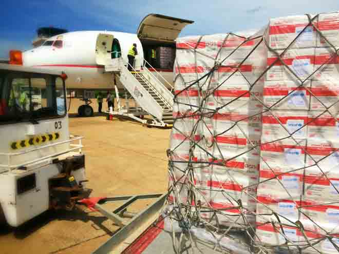 A plane at Juba International Airport, South Sudan brings cartons of food to treat malnourished children. Photo: UNICEF/PFPG2014P-0548/Pires